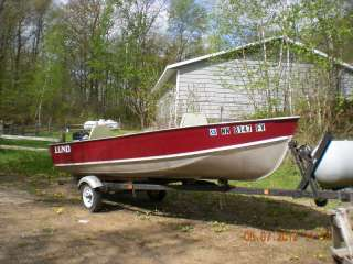 fishing boat, motor and trailer 1975 Lund 16 ft aluminum fishing boat